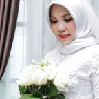 Fiancee of man killed in Lion Air plane crash poses for wedding pictures alone