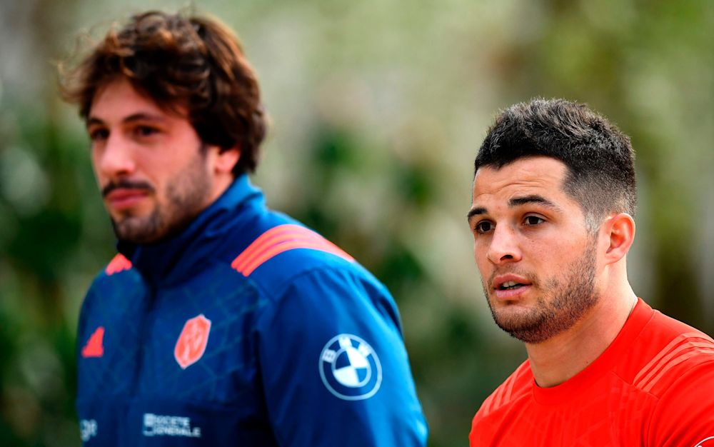 France stars Brice Dulin (right) and Kevin Gourdon walk out for training - AFP or licensors