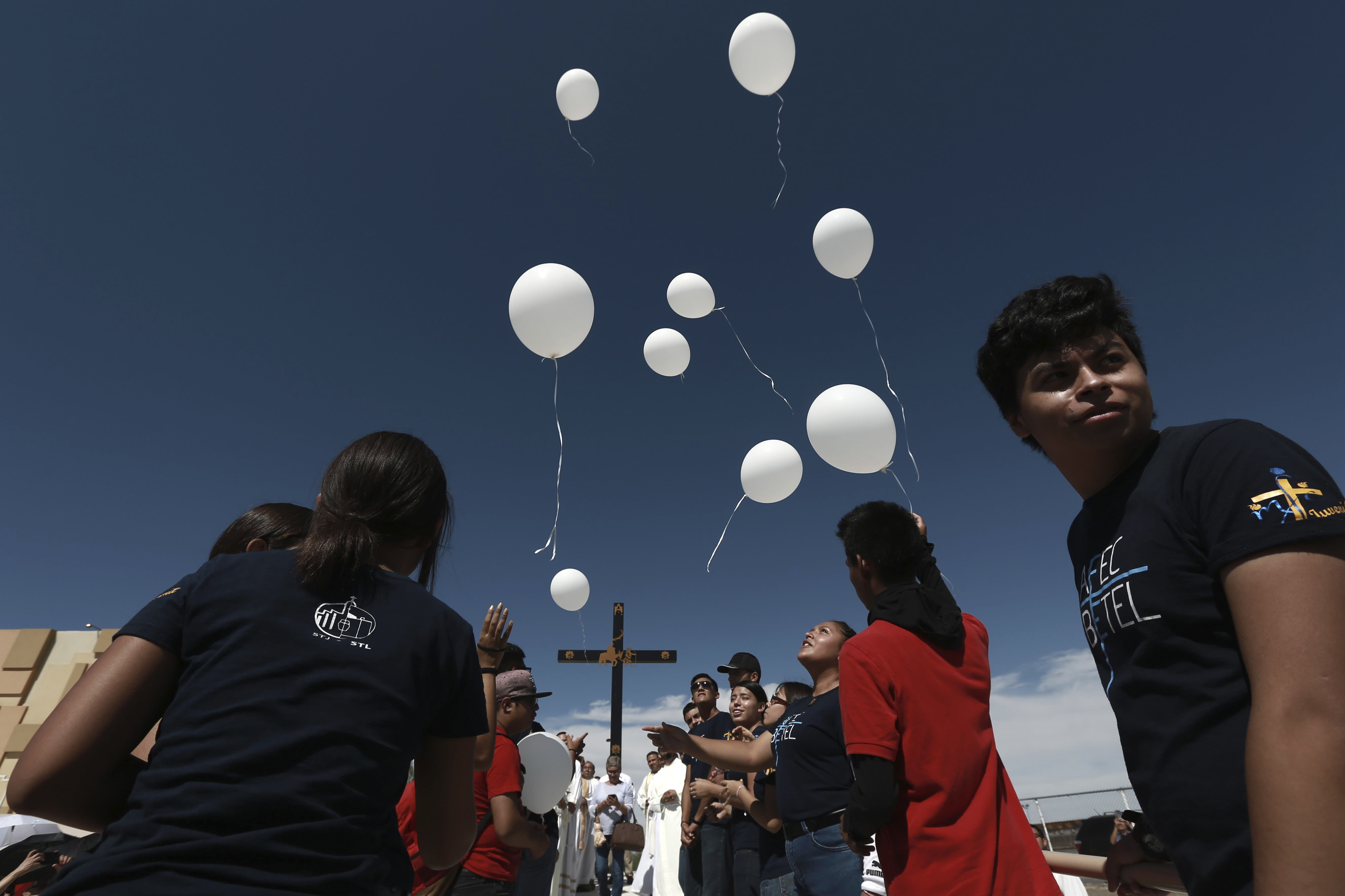 Faithful release balloons during a Mass for peace, in Ciudad Juarez, Mexico, Saturday, Aug. 10, 2019, marking the one week anniversary of a shooting that killed 22 at a Walmart in El Paso. Authorities say the man accused of carrying out last weekend's deadly mass shooting confessed to officers that he had been targeting Mexicans. (AP Photo/Christian Chavez)