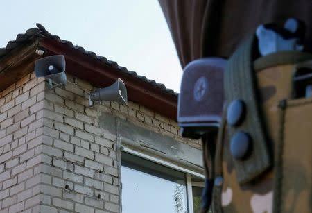 Loudspeakers broadcasting Ukrainian radio are seen in the village of Grechishkino, Ukraine, August 11, 2016. REUTERS/Gleb Garanich
