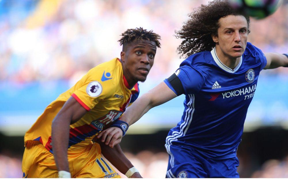 Wilfried Zaha and David Luiz battle for the ball - Rex Features