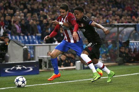 Atletico Madrid's Sime Vrsaljko in action with Bayer Leverkusen's Wendell