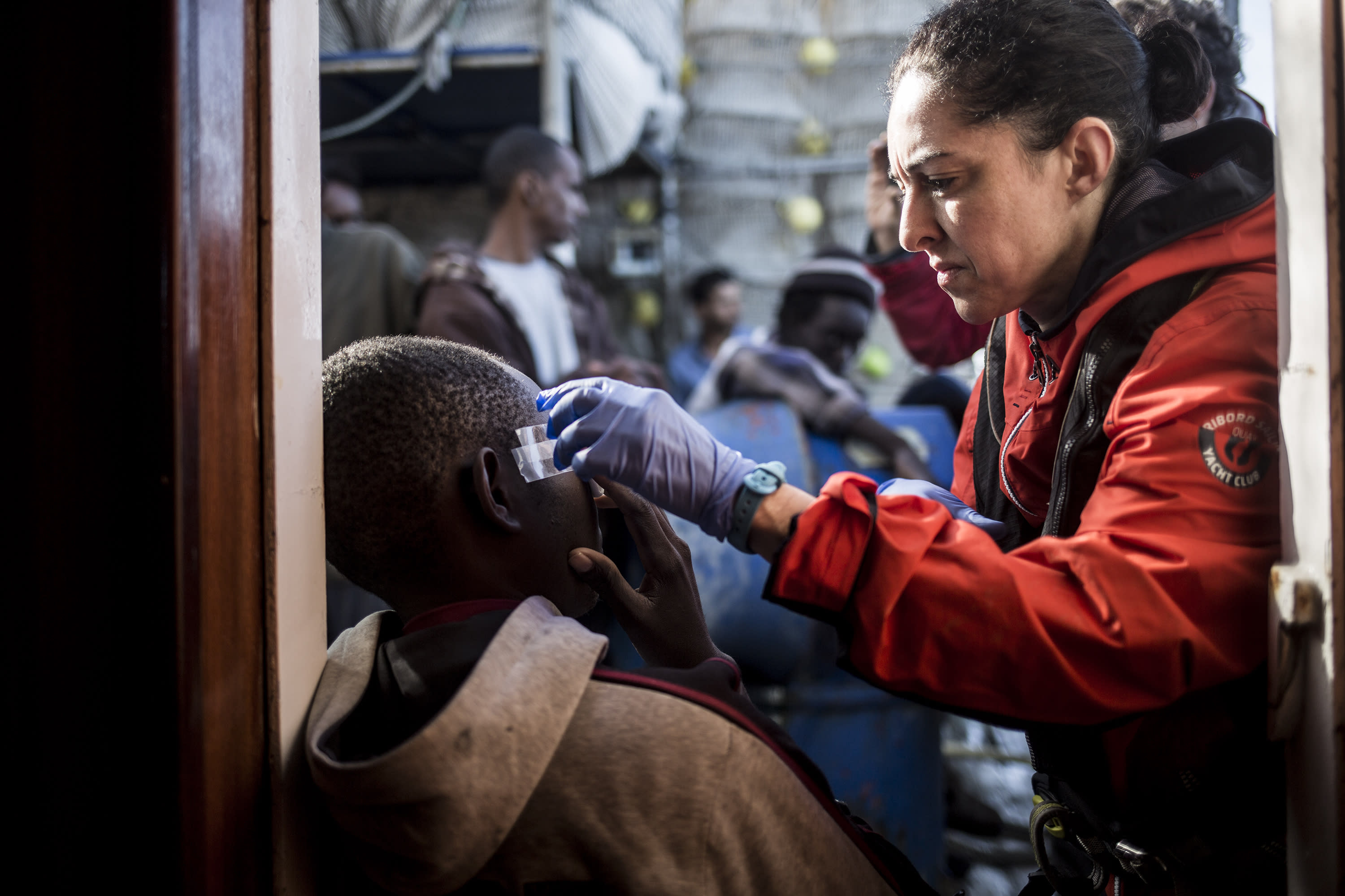In this photo taken on Saturday, Nov. 24, 2018 photo, a migrant receives medical assistance after being rescued by Nuestra Madre de Loreto, a Spanish fishing vessel, two days ago off the Libyan shore. The Spanish NGO Proactiva Open Arms carried medical checks and provided food, clothes and blankets to the migrants. (AP Photo/Javier Fergo)
