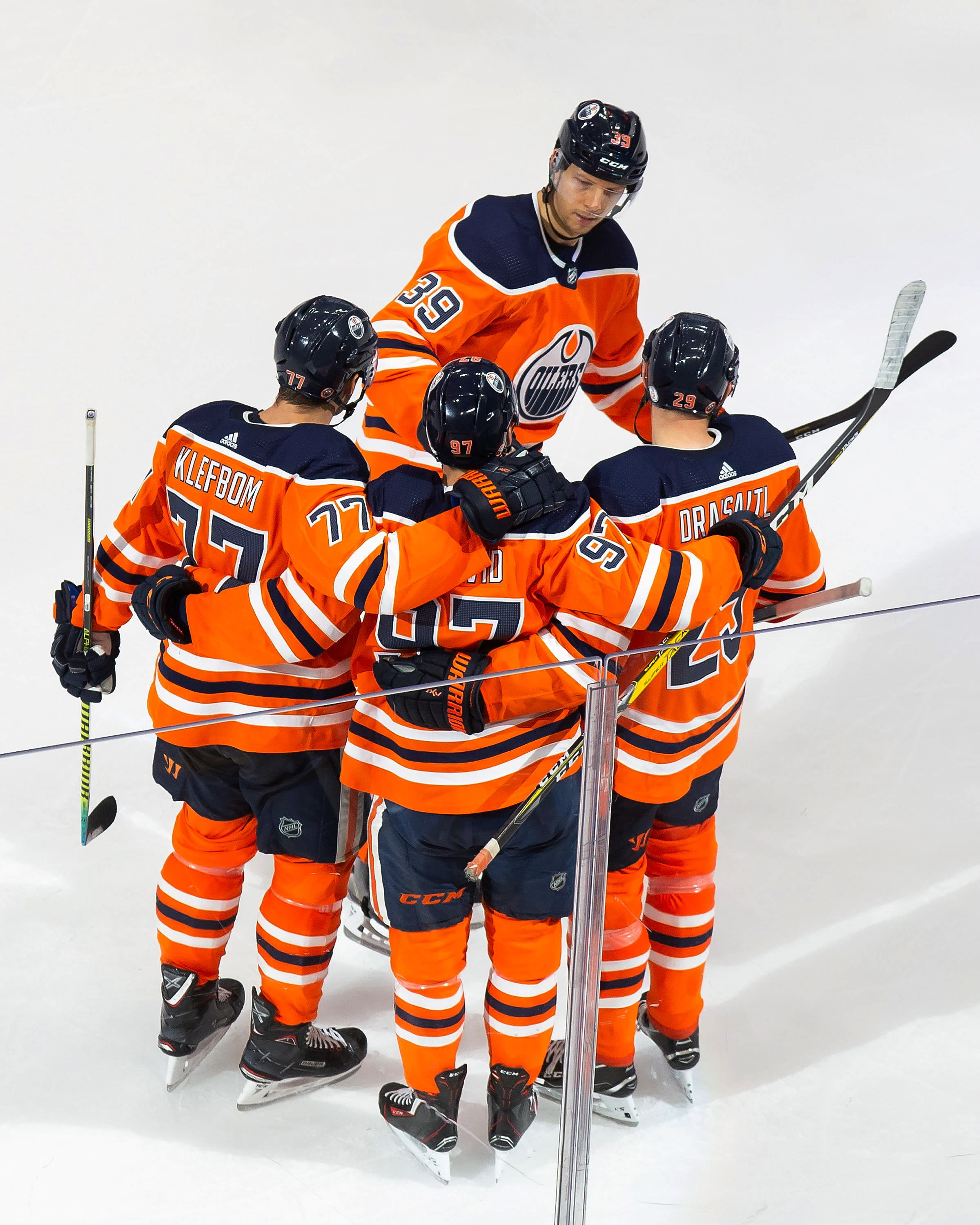 Edmonton Oilers' Oscar Klefbom (77), Alex Chiasson (39), Connor McDavid (97) and Leon Draisaitl (29) celebrate a goal against the Chicago Blackhawks during the second period of an NHL hockey playoff game Monday, Aug. 3, 2020, in Edmonton, Alberta. (Codie McLachlan/The Canadian Press via AP)