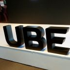 Uber trims losses and grows business, plans new stock sale