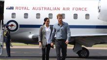 La lluvia recibe a Enrique y Meghan en una ciudad australiana golpeada por la sequía