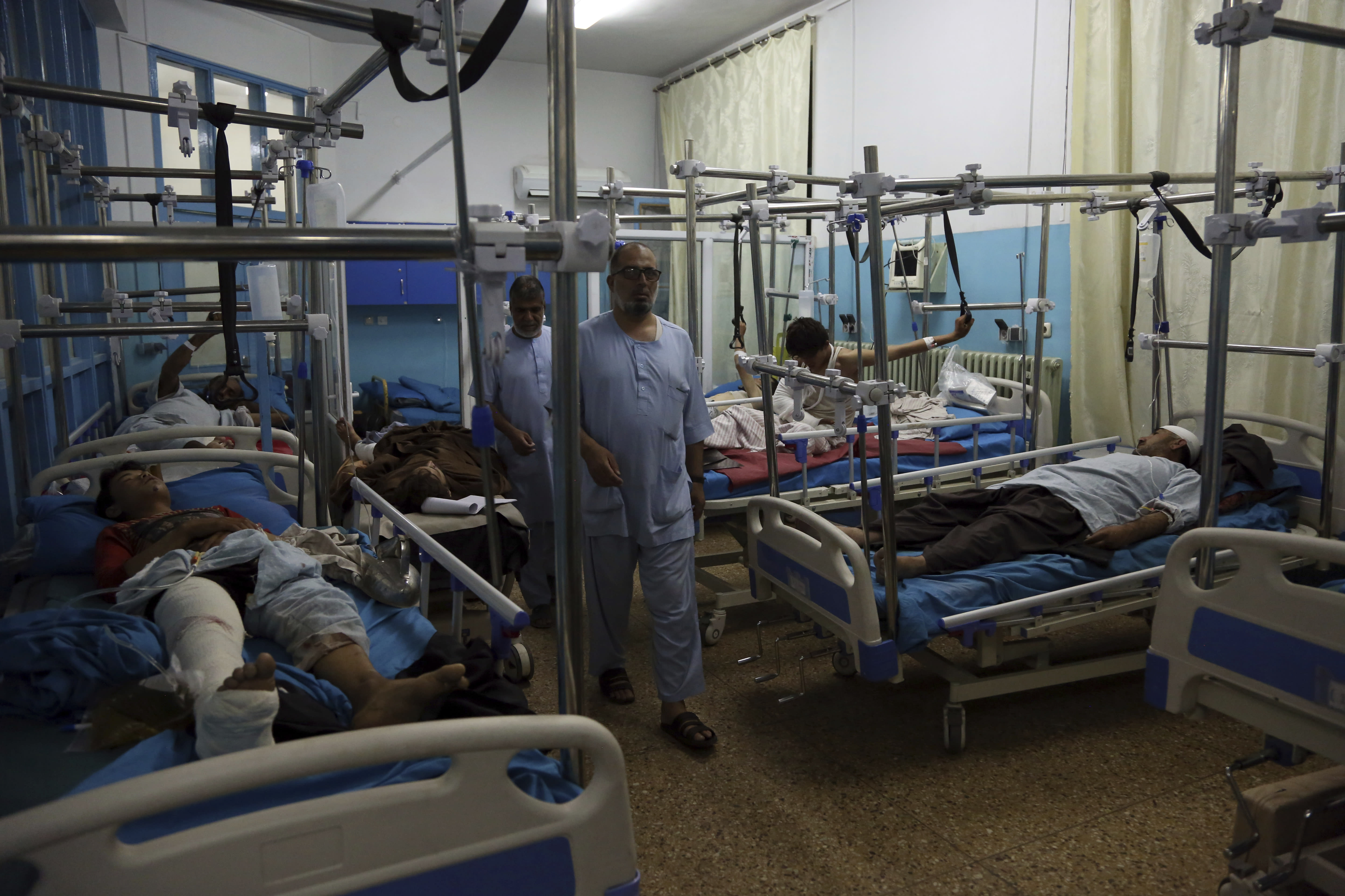 Wounded men receive treatment in a hospital after a large explosion in Kabul, Afghanistan, Monday, Sept. 2, 2019. The Taliban claimed responsibility for a large explosion in the Afghan capital Monday night, which government officials said targeted an area home to several international organizations and guesthouses. (AP Photo/Rahmat Gul)
