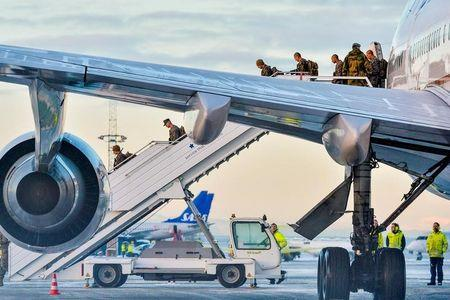 FILE PHOTO: A Boeing 747 with some 300 U.S. Marines, who are to attend a six-month training to learn about winter warfare, lands in Stjordal, Norway January 16, 2017. NTB Scanpix/Ned Alley/via REUTERS