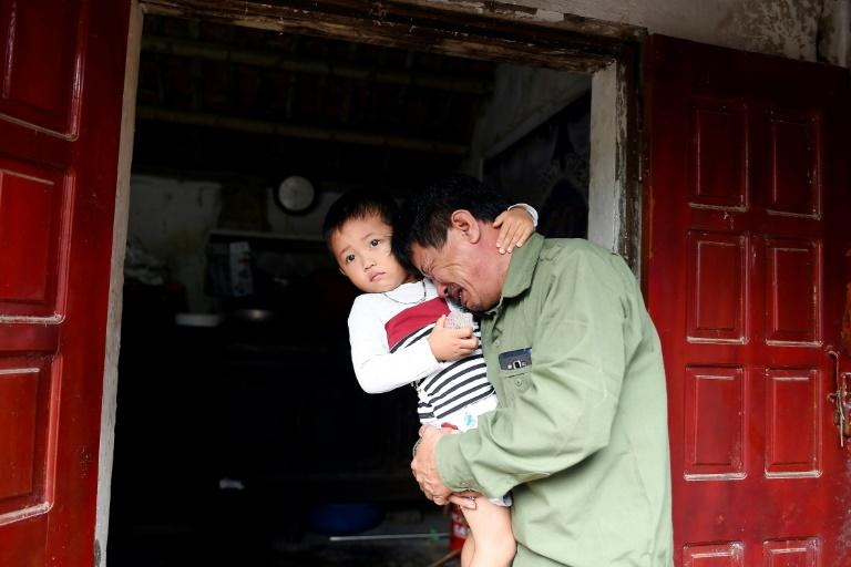 The father of Le Van Ha, who is feared among the 39 people found dead in a truck in Britain, mourns for his son (AFP Photo/NHAC NGUYEN)
