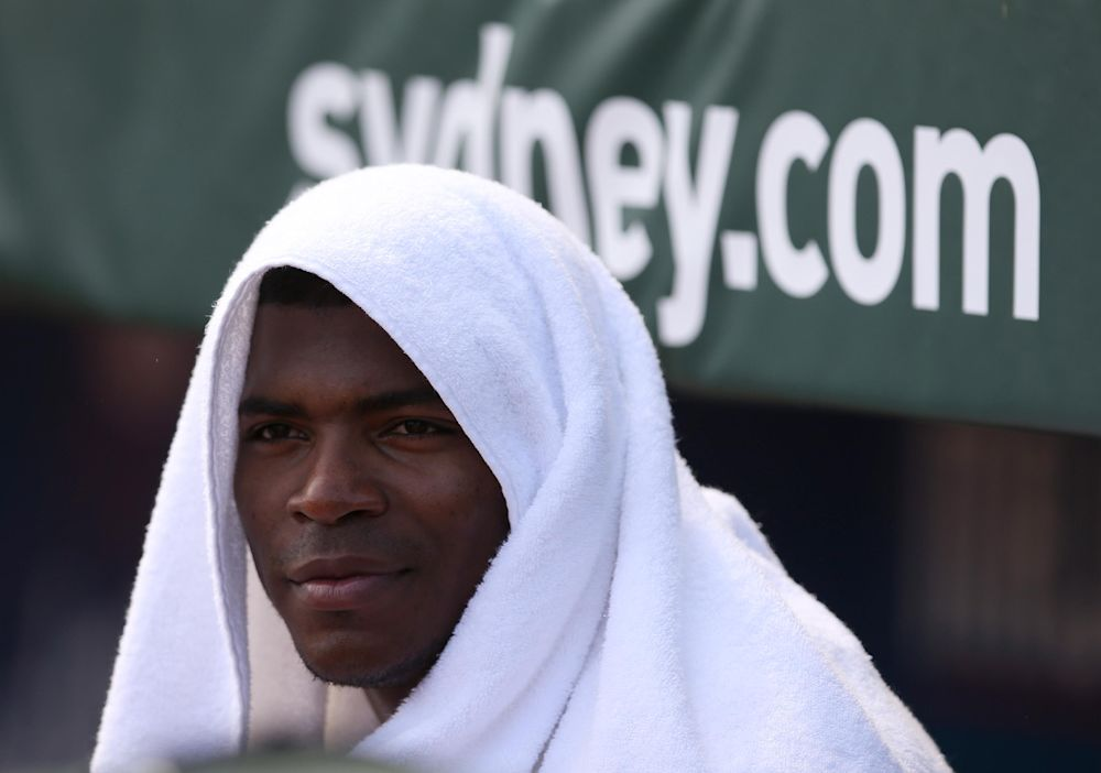 Los Angeles Dodgers' Yasiel Puig covers his head with a towel during the second game of the two-game Major League Baseball opening series between the Los Angeles Dodgers and Arizona Diamondbacks at the Sydney Cricket ground in Sydney, Sunday, March 23, 2014