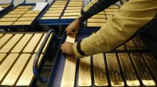 Gold rises on wobbly dollar; stocks surge after U.S. govt shutdown ends