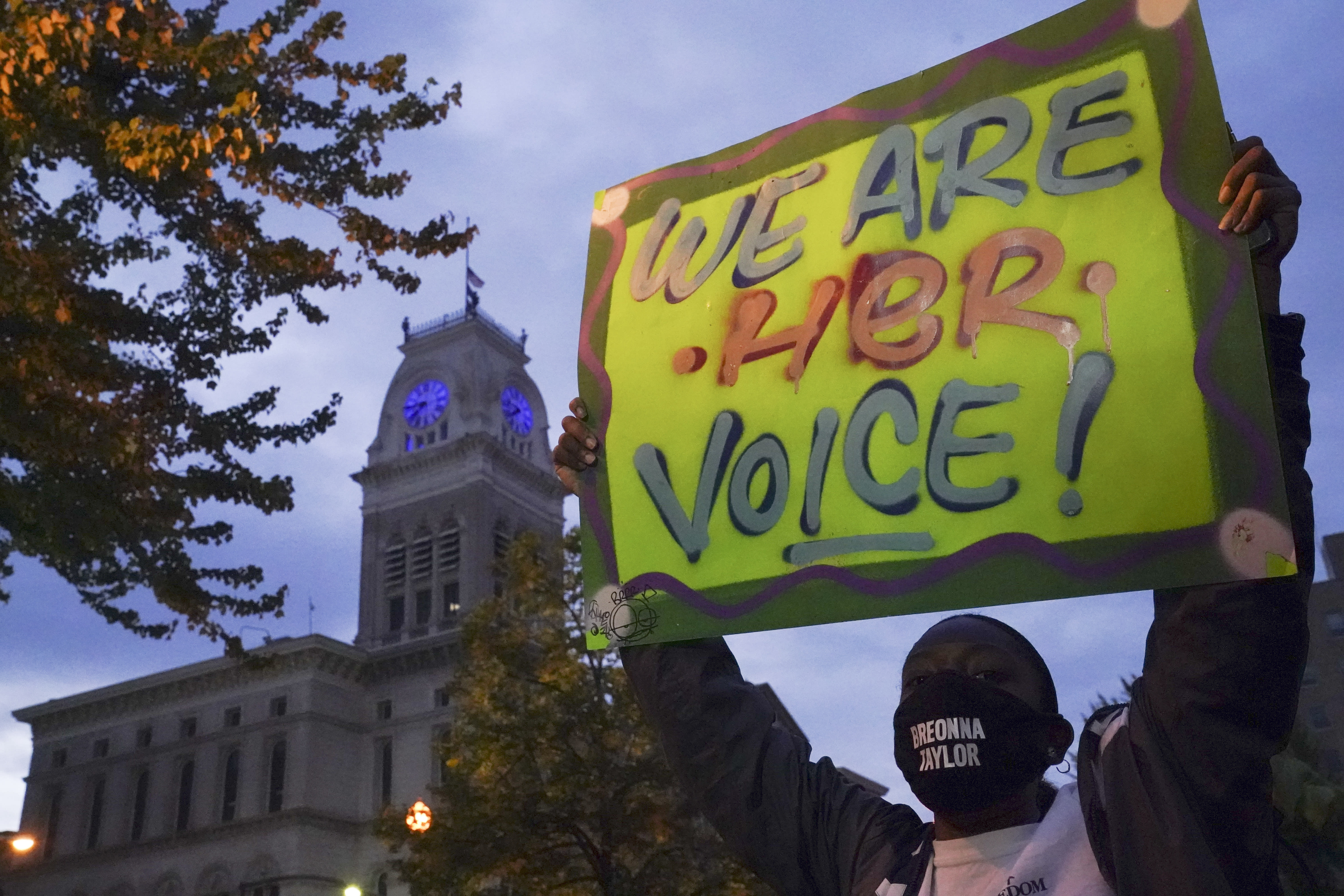 A protester stands in Jefferson Square, Thursday, Sept. 24, 2020, in Louisville, Ky. Authorities pleaded for calm while activists vowed to fight on Thursday in Kentucky's largest city, where a gunman wounded two police officers during anguished protests following the decision not to charge officers for killing Breonna Taylor. (AP Photo/John Minchillo)