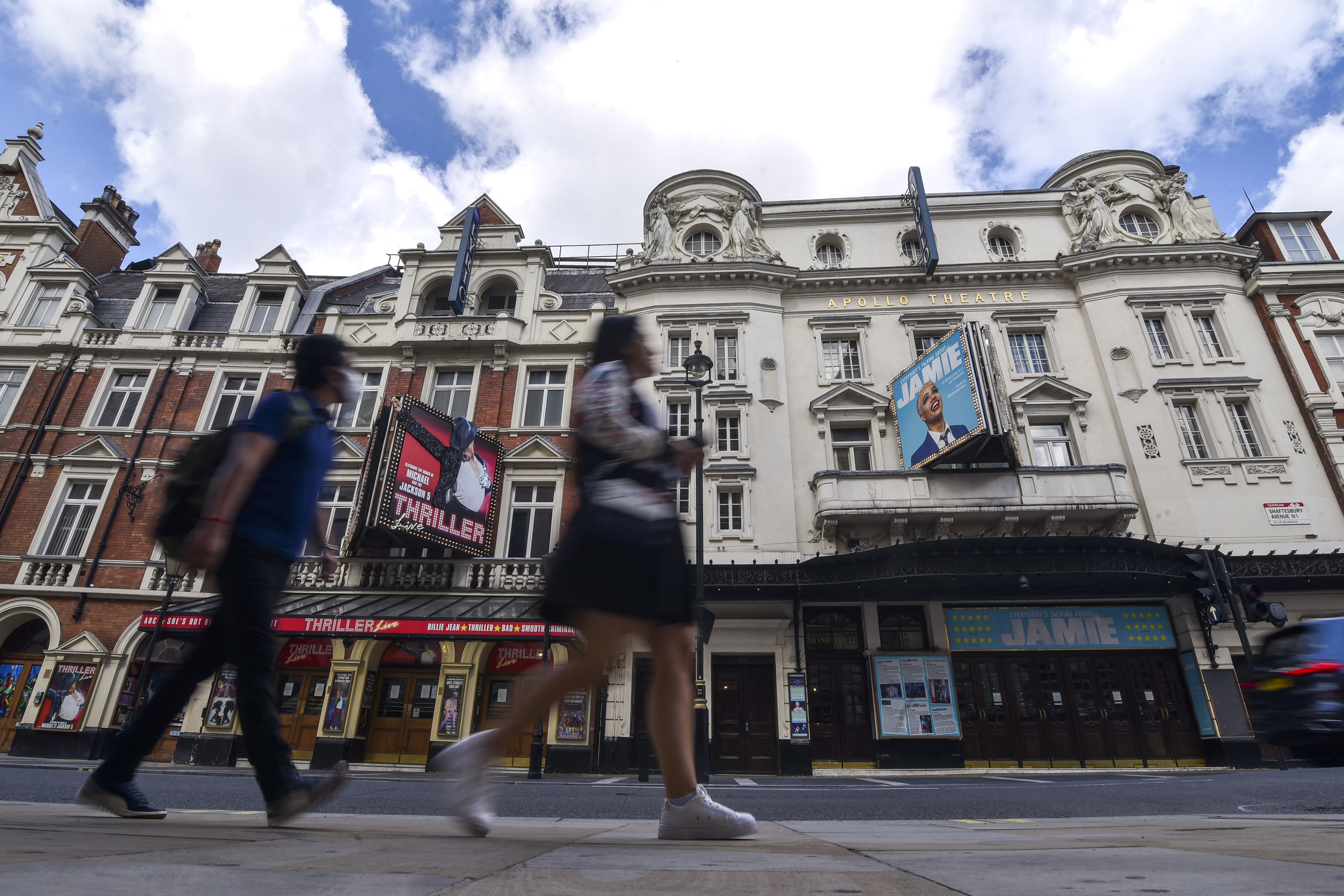 Theaters in the West End are closed due to the Coronavirus outbreak, in London, Saturday, Aug. 1, 2020. Prime Minister Boris Johnson put some planned measures to ease the U.K.'s lockdown on hold Friday, saying the number of new coronavirus cases in the country is on the rise for the first time since May. He called off plans to allow venues, including casinos, bowling alleys and skating rinks, to open from Saturday, Aug. 1. (AP Photo/Alberto Pezzali)