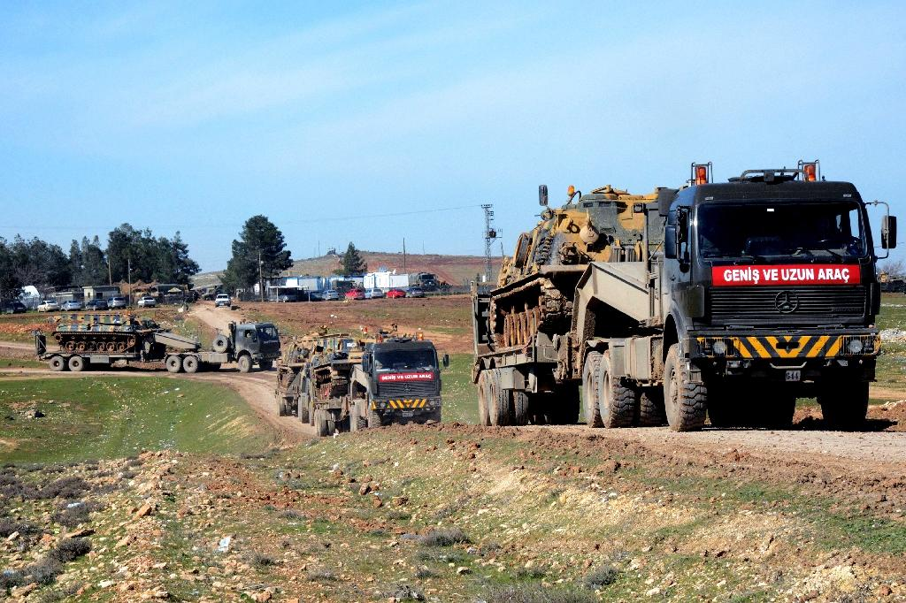 Turkish military vehicles and tanks are deployed in Surac, near the border with Syria (AFP Photo/Ilyas Akengin)