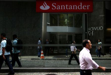 People walk past a Banco Santander branch in downtown Rio de Janeiro