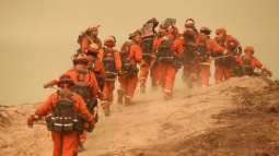 California firefighters battle wildfires in hot, windy weather