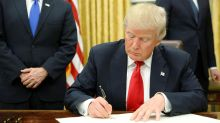 President Trump signs first executive orders