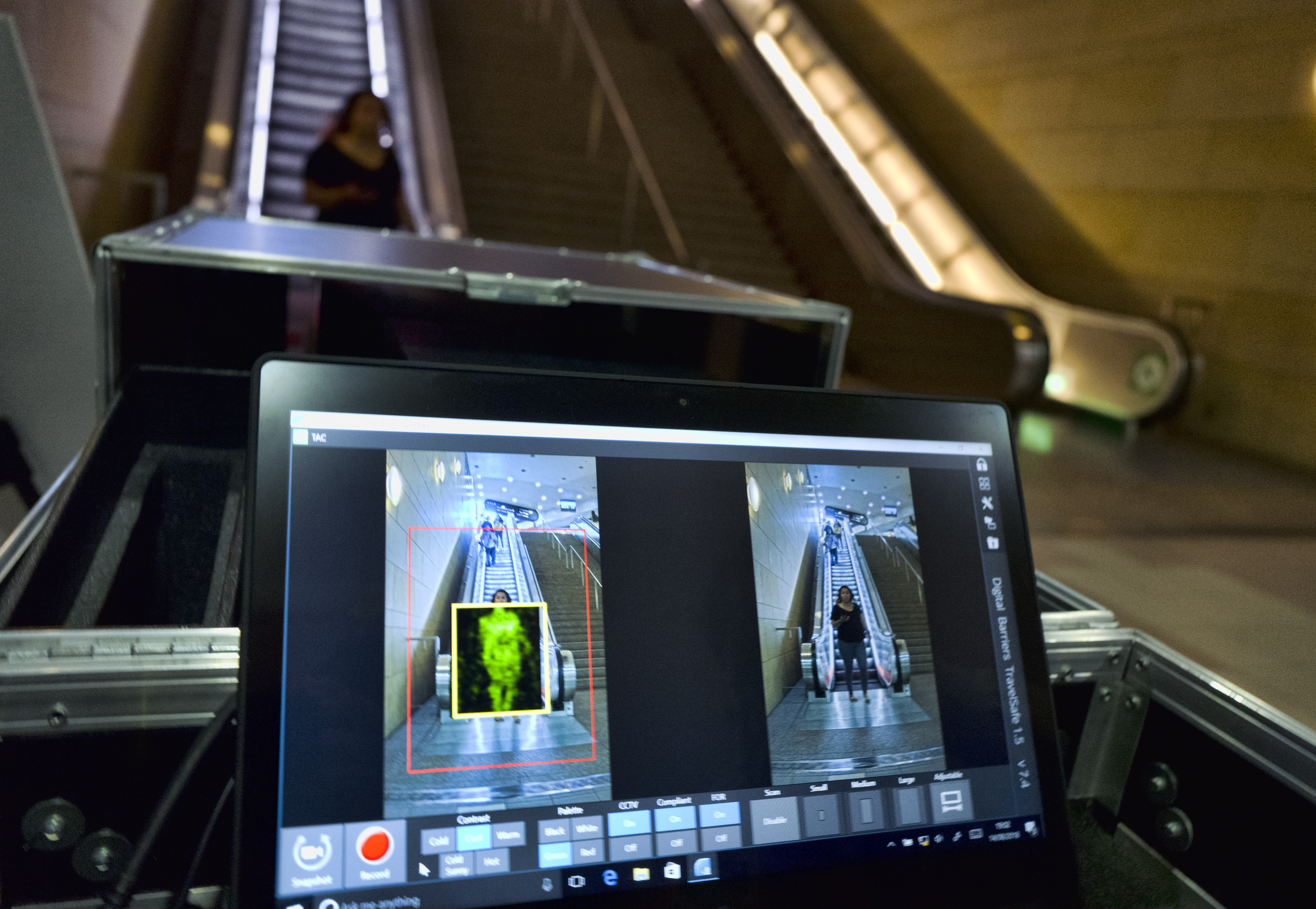 An arriving passenger to Union Station in Los Angeles is seen on the ThruVision technology that reveals suspicious objects on people during a Transportation Security Administration demonstration on Tuesday, Aug. 14, 2018. Los Angeles is poised to have the first mass transit system in the U.S. with body scanners that screen passengers for weapons and explosives. (AP Photo/Richard Vogel)