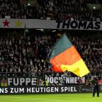 Fans delay Bundesliga match by throwing Easter eggs on field