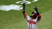Acuna homers to lead Braves past Phillies 5-2 in first of 2