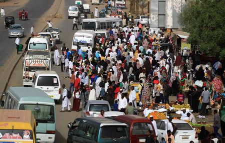 Sudanese residents wait for buses on a street in Khartoum, Sudan, May 4, 2019. REUTERS/Umit Bektas