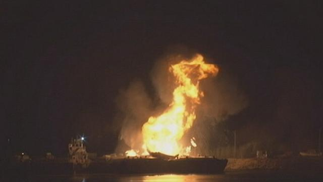 2 Barges Erupt in Flames After Explosions