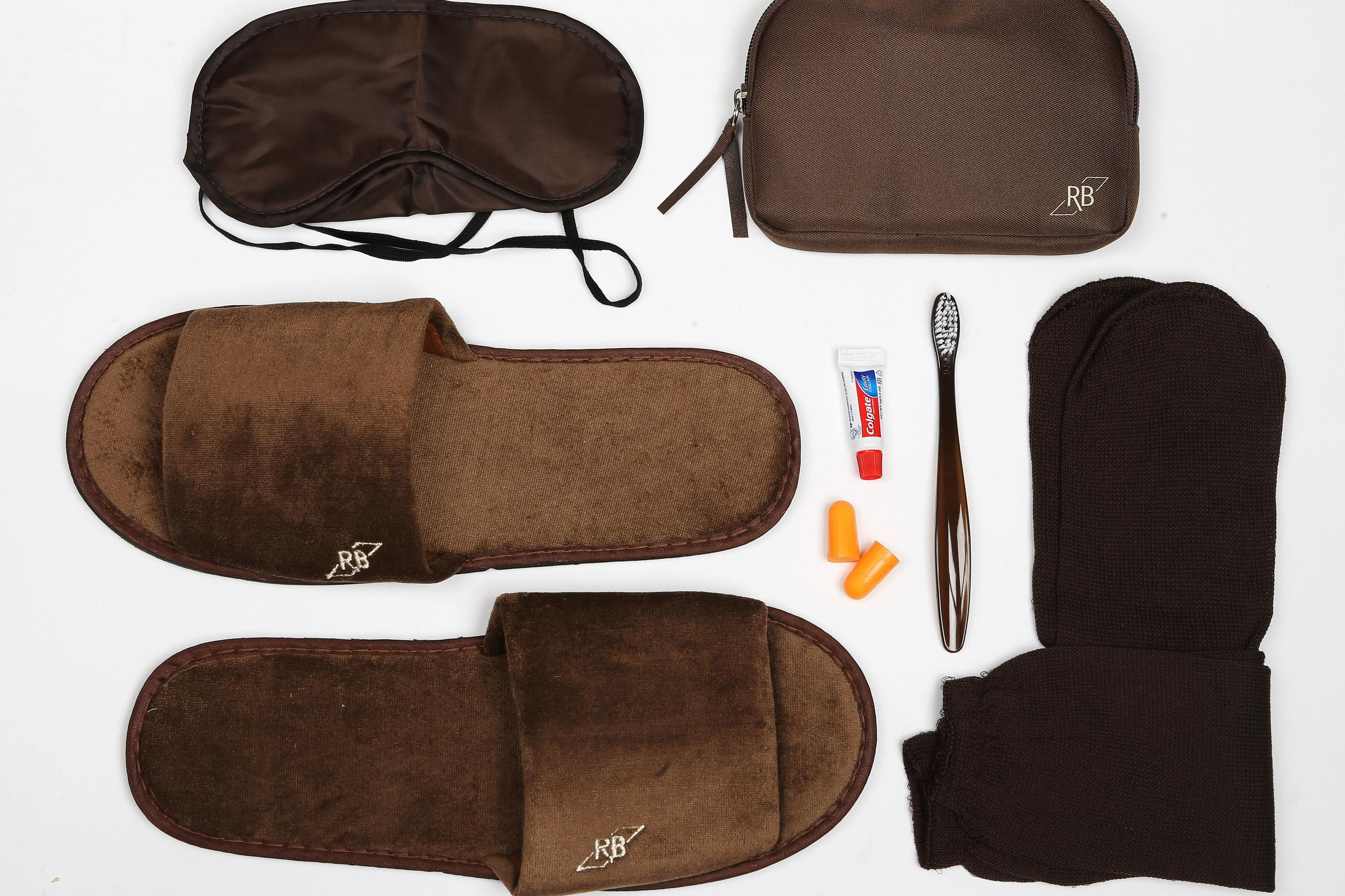<p><strong>What do you get?</strong> Inside the little brown bag passengers find: Eye mask, socks, toothbrush, toothpaste, ear plugs, slippers<br /> <strong>Best bit of the kit?</strong> The slippers!</p>