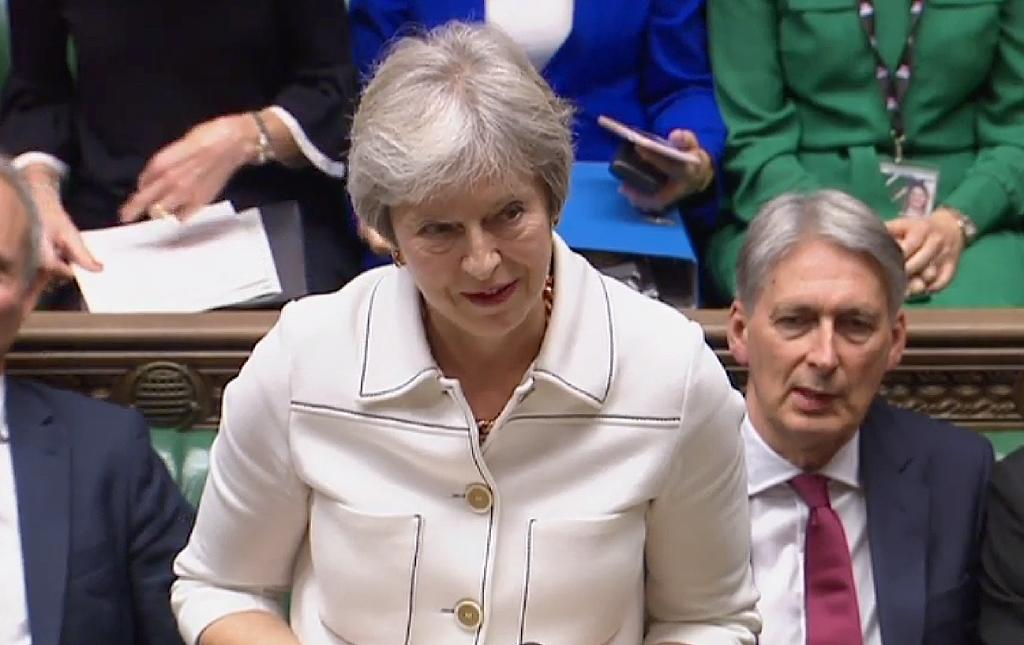 A video grab from footage broadcast by the UK Parliament shows Britain's Prime Minister Theresa May speaking in the House of Commons on the latest progress on exit negotiation talks with the EU
