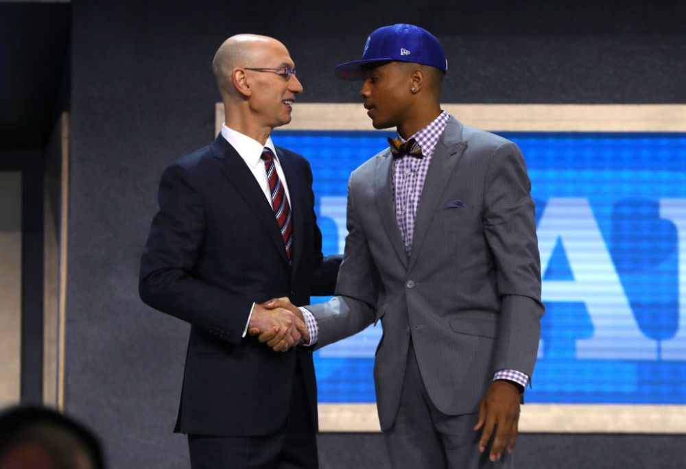 Markelle Fultz and NBA Commissioner Adam Silver discuss their chicken sandwiches of choice. (Mike Stobe/Getty Images)