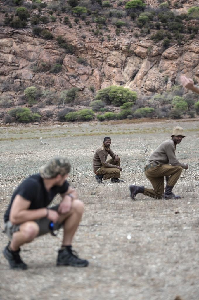 Veterans from the US, Australia and elsewhere share their expertise in the battle to save rhinos by training rangers in South Africa's Kuduland Reserve (AFP Photo/Mujahid Safodien)