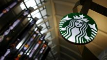 Starbucks reports cooling quarterly growth and pares outlook