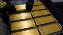 Oro cae cerca de mínimo de dos semanas ante fortaleza del dólar