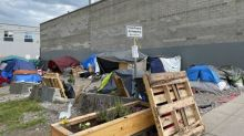 Housing minister says sanctioned homeless camps 'not an option' he wants to pursue