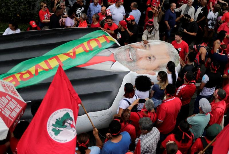 An inflated effigy of former Brazilian President Luiz Inacio Lula da Silva is displayed as supporters wait for his arrival after he was released from prison, in Sao Bernardo do Campo