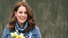 The Duchess of Cambridge recycles Sportmax coat for Roe Green Primary School visit