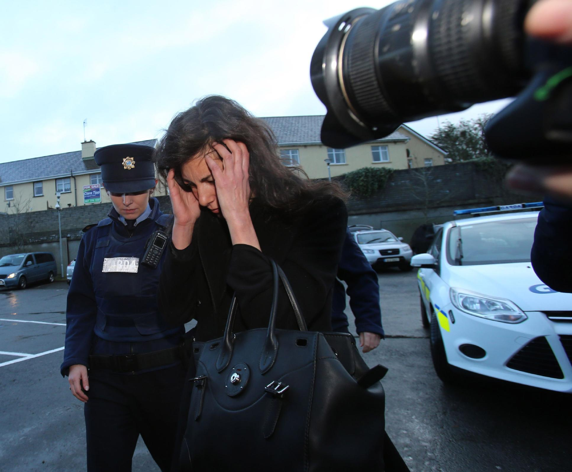 Jenny Lauren, centre, Niece of fashion designer Ralph Lauren, arrives at Killaloe District Court, in Killaloe, Ireland, Tuesday, Jan. 7, 2014. The niece of fashion designer Ralph Lauren has appeared in an Irish court on charges of being drunk and disorderly on a New York-bound plane. Jewelry designer Jenny Lauren was arrested after a Delta flight from Barcelona made an unscheduled stop at Shannon Airport on Monday. (AP Photo/PA, Niall Carson) UNITED KINGDOM OUT