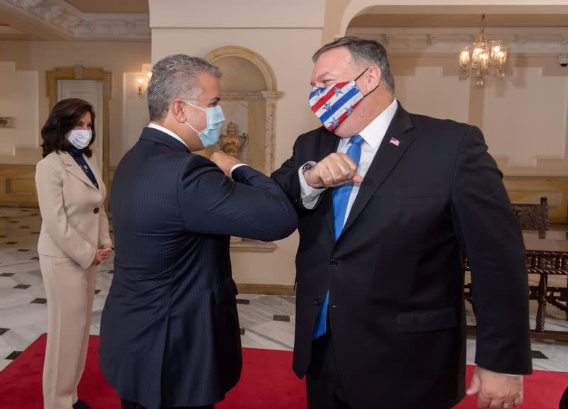 Colombian President Ivan Duque Marquez and U.S. Secretary of State Mike Pompeo bump elbows before attending a meeting at the presidential house in Bogota