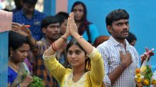 Indians throng temple to crack Trump's visa curbs