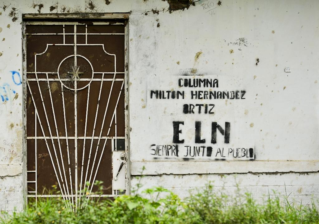 ELN (National Liberation Army of Colombia) guerrilla graffiti pictured on a wall in El Palo, department of Cauca, Colombia, on March 15, 2016 (AFP Photo/Luis Robayo)