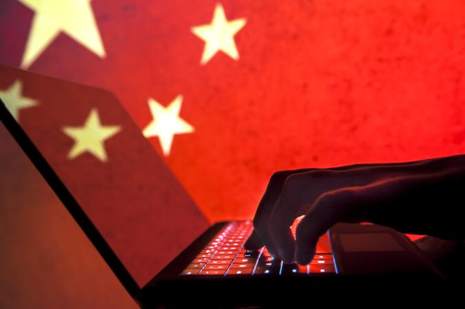 Cybercriminal, hacker China flag background.