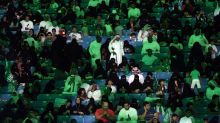In a first, women throng Saudi stadium for national day