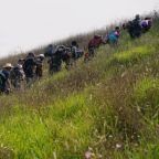 Central American migrants resume their march toward U.S. border