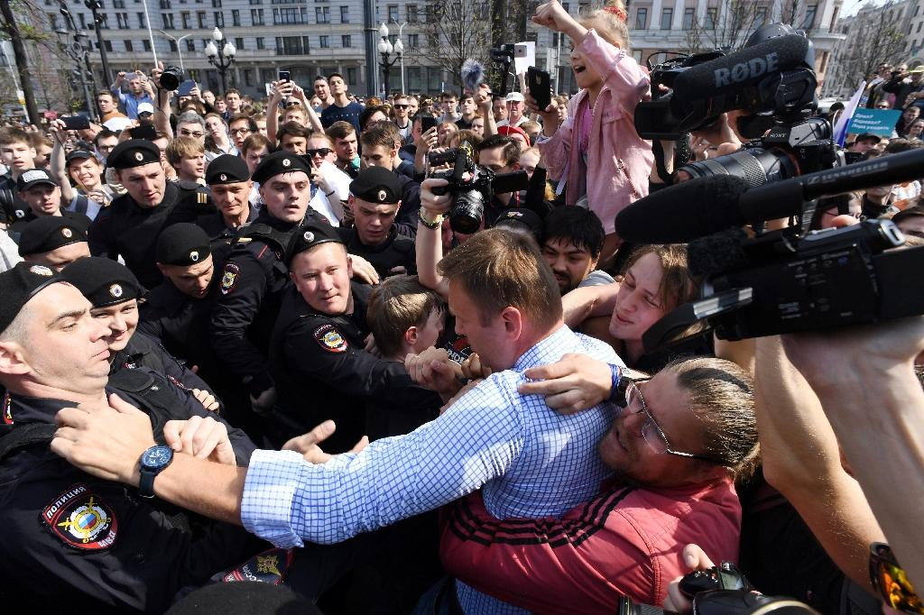 Russian opposition leader Alexei Navalny was grabbed by police and carried away during a protest against President Vladimir Putin in May