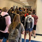 A Georgia high school that suspended students for posting pictures of crowded hallways now has 9 reported cases of coronavirus