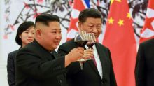 Kim Jong-un says he will work with China to secure 'true peace' after meeting with president XI Jinping