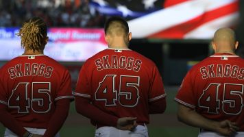 Artist honors Skaggs with mural by HS baseball field