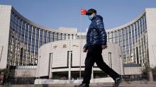 Asian markets mixed after China cuts loan prime rate
