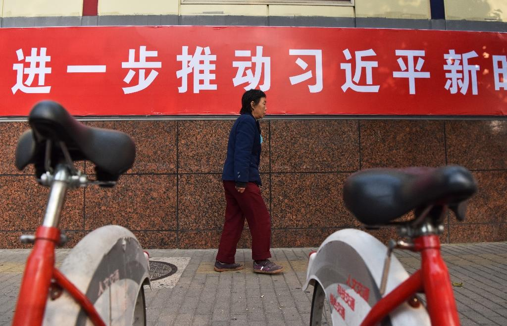 """A slogan in a Beijing street reads """"Promote Xi's thought of socialism with Chinese characteristics in the new era, making it a lively practice in Beijing"""""""