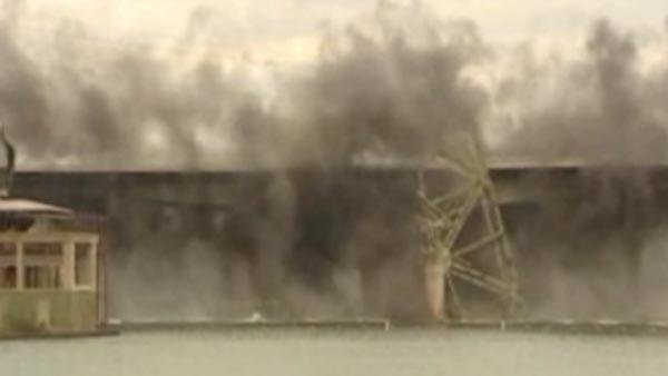 Crews implode bridge in Texas