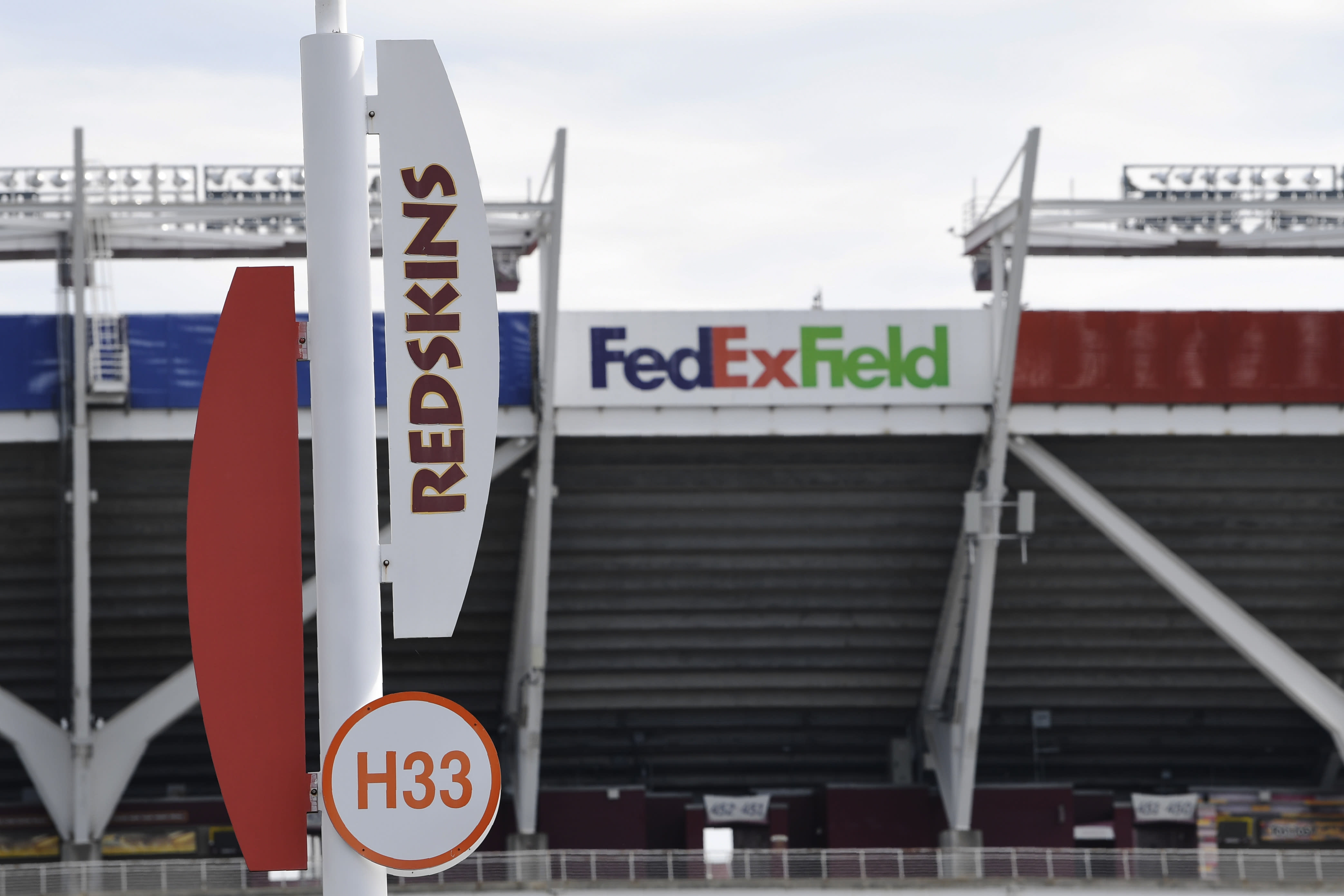 """Signs for the Washington Redskins are displayed outside FedEx Field in Landover, Md., Monday, July 13, 2020. The Washington NFL franchise announced Monday that it will drop the """"Redskins"""" name and Indian head logo immediately, bowing to decades of criticism that they are offensive to Native Americans. (AP Photo/Susan Walsh)"""